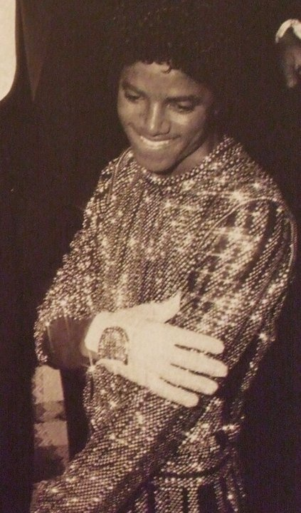 Michael, wearing glove, slightly biting his lip.....what was I saying?