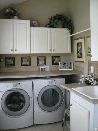 I like this idea, but I would elevate the washer and dryer and put some storage drawers beneath them