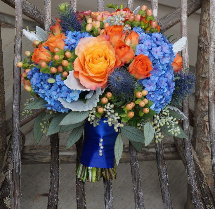 I had so much fun designing this blue, orange and peach bouquet! Flowers are hydrangeas, Free Spirit Roses, peach hypericum berries, Spray Roses and lush seeded Eucalyptus (flowerartistry.ca)