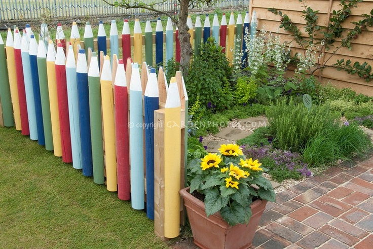 Backyard Fence Decorating Ideas : Crayon picket fence Good idea for a daycare or preschool More
