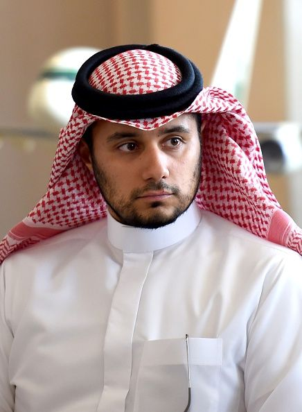 Prince Khaled Alwaleed bin Talal, the son of Saudi Arabia's billionaire Prince Alwaleed bin Talal, looks on as his father speaks during a press conference in the Saudi capital, Riyadh, on July 1, 2015.