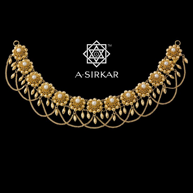 Kalyani Necklace, it was otherwise loosely referred to as 'pushpa-har'. Painstakingly crafted and assembled by hand in soft yellow 22K gold, the ornament looks fabulous as a choker but works equally elegantly as a necklace provided you allow it the space and not subdue it by pairing it with a saree the border of which is heavily patterned.
