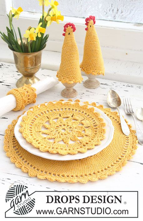 "Set comprises: Crochet DROPS place mat, egg warmer and serviette ring in ""Safran"" and ""Glitter""."