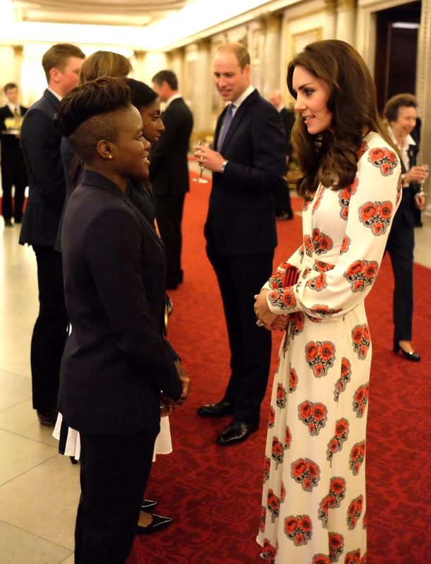 I loooooove Nicola Adams' whole look here. KM look rather stuffy standing in front of her.