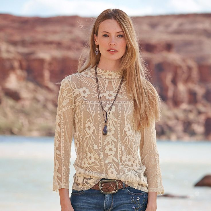 """Anthro ivory lace cowlneck + brown belt + AG jeans + anthro booties. DREAMSCAPE LACE TEE--A long-sleeve lace tee shirt of delicate dot mesh, over-embroidered with blooms and vines. Camisole sold separately. Nylon. Hand wash. Imported. Exclusive. Sizes XS (2), S (4 to 6), M (8 to 10), L (12 to 14), XL (16). Approx. 25""""L."""