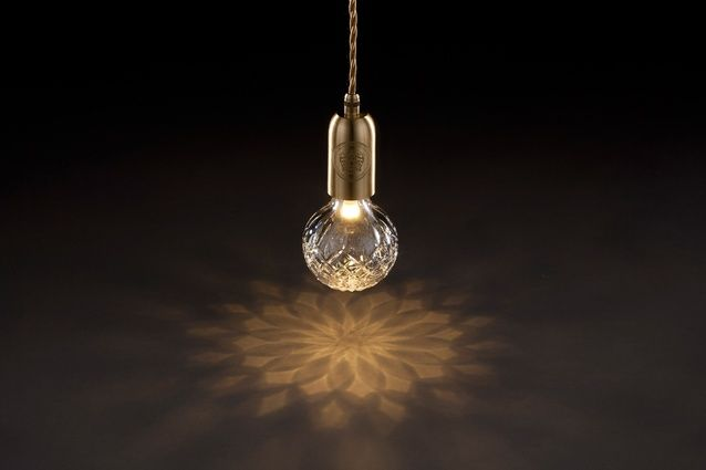 The cut crystal spills gorgeous geometric light and shadow.