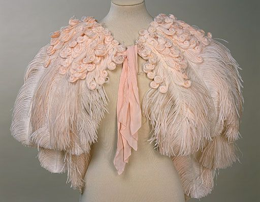 Pink Ostrich Feather Cape 1937 ~  Feathers are off white, brown or black in the wild, the feathers can then be dyed to bright or pastel shades, in this instance a baby pink. Huge ostrich farms were established in South Africa in the late nineteenth century to breed the birds specifically for their plumage, which was then imported to Britain.