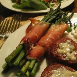A few spears of asparagus, some slices of prosciutto, and a bit of creamy Neufchatel cheese is all you need to assemble this fancy little side dish. Make a few more, and serve them on an appetizer tray.