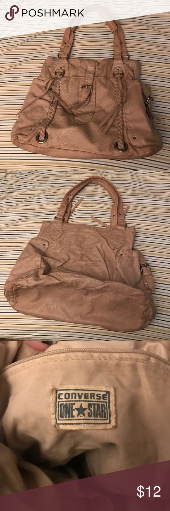 Tan Converse purse 👛 Tan Converse purse. Has a small side zipper pocket inside with a wide open pocket as well. The sides also are functioning pockets that close. Great for any occasion and season. Converse Bags Shoulder Bags