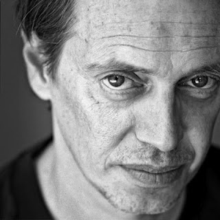 Steve Buscemi - yep!!!! He has his own look and truly owns it!  He's the guy you never would find humorous but he is even if he looks mean half  the time. He's charming.