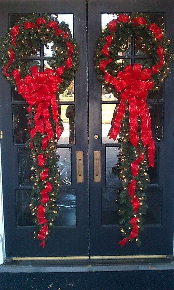 A unique to up the decorating impact of a door wreath - add trailing garland.
