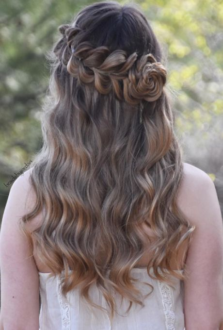 """Brides.com: . Placing a few flowers in your hair for your wedding day isn't a novel concept. But turning your hair into a flower shape? That's seriously eye-catching--and way easier than it looks. """"I created the rose by rolling a three-strand braid on its side so that it forms the shape of a rose petal. This type of braid looks great on all hair types because you could pull on the edges of the braid to make it look fuller and more voluminous,"""" says Jordan MacKenzie, the hairstylist behind…"""