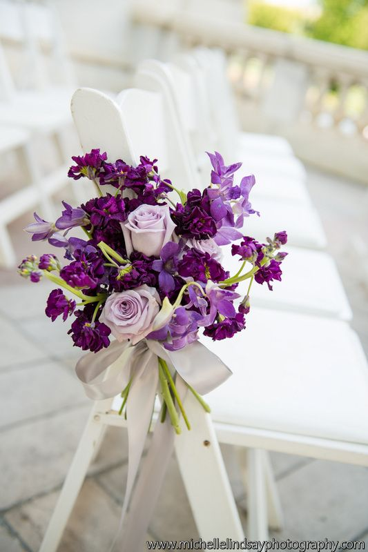Love the purple wedding aisle flowers