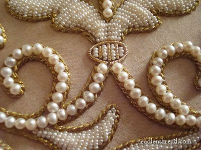 Detail of frame embellished with gold threadwork, freshwater pearls, & beadwork -- also gold cord, gold purl, pearl purl, and rhinestones...  ~ by Larissa Borodich. (3rd of three pins)