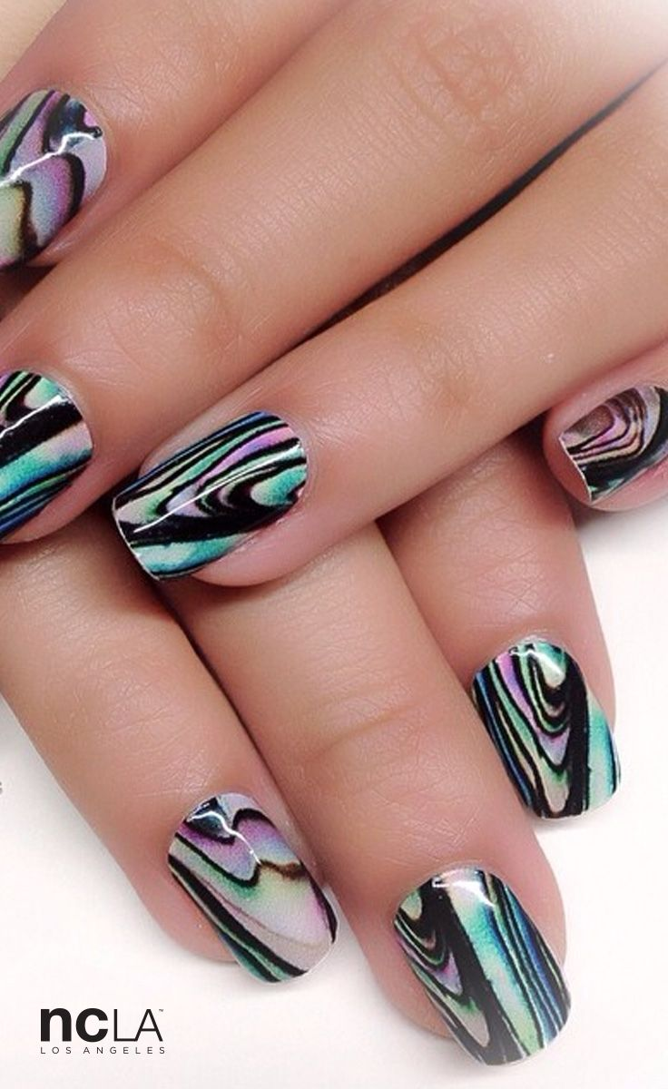 Party on in this brilliant abalone shell print nail wrap featuring subtle texturing and an iridescent sheen.
