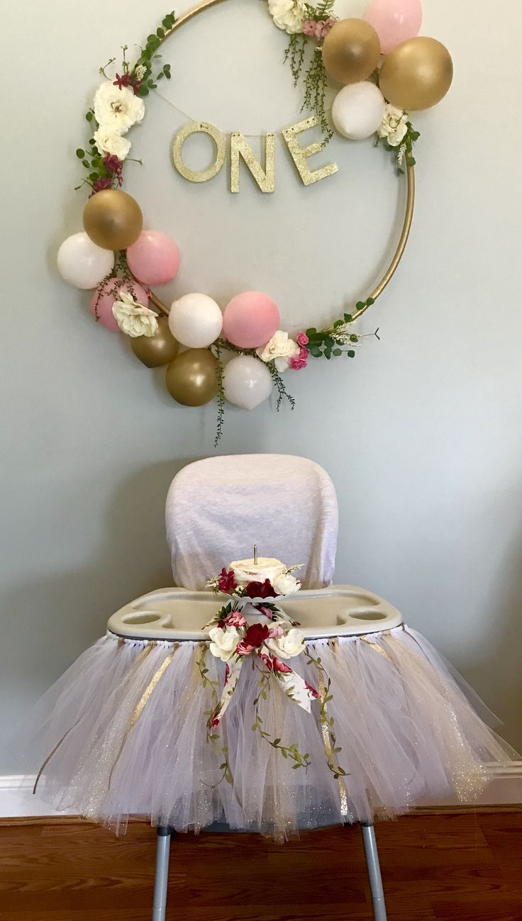 Floral pink and gold first birthday decorations. Hula hoop