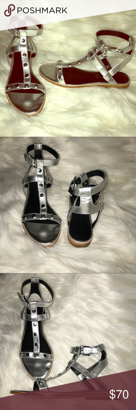 """Rebecca Minkoff⭐️Silver T strap/ Gladiator Sandals Rebecca Minkoff """"Sandy"""" Sandals. These sandals are super cute and stylish. BRAND NEW!! (no box or tags) Embellished with flat nail studs all over a shiny silver color. They have about a half inch heel for a tiny lift. T strap design with adjustable buckle. These shoes sport a smooth man made outsole with a padded footbed. Faux leather. Super cute with a white Tshirt and pair of jeans or a casually chic dress! Rebecca Minkoff Shoes Sandals"""