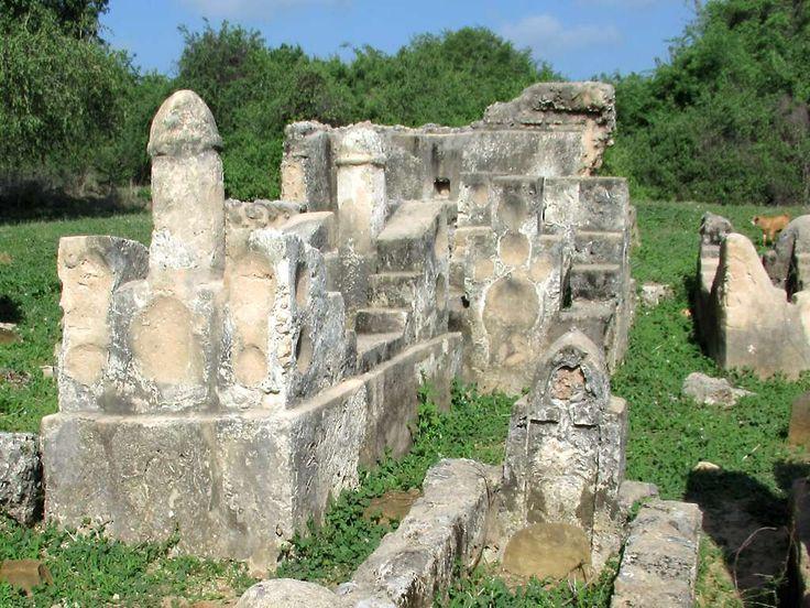 Several of the Tombs of the Kilwa Sultans on Kilwa Kisiwani Island, Tanzania, include phallic pillars. Originally ceramic plates decorated the tombs.