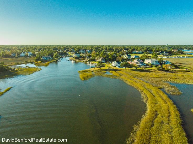 136 Skysksail Dr Wilmington, NC provides privacy on a .93 acre lot with views of the Intracoastal Waterway and Wrightsville Beach. This beautiful home comes with a private pier with three 40 ft boat slips and jet ski ramp. #Wilmington #LuxuryRealEstate #WaterfrontHome