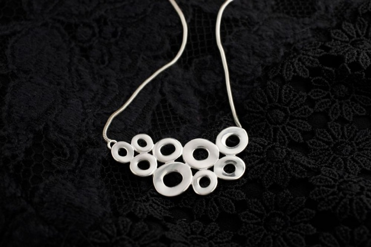 John Rocha Jewellery, part of the Circ Collection. Made of Sterling Silver, this necklace features organic circles cluster together to form a stunning pendant on snake chain, satin finished this is a simple and elegant. Ideal for any occasion. - new to our online shop!