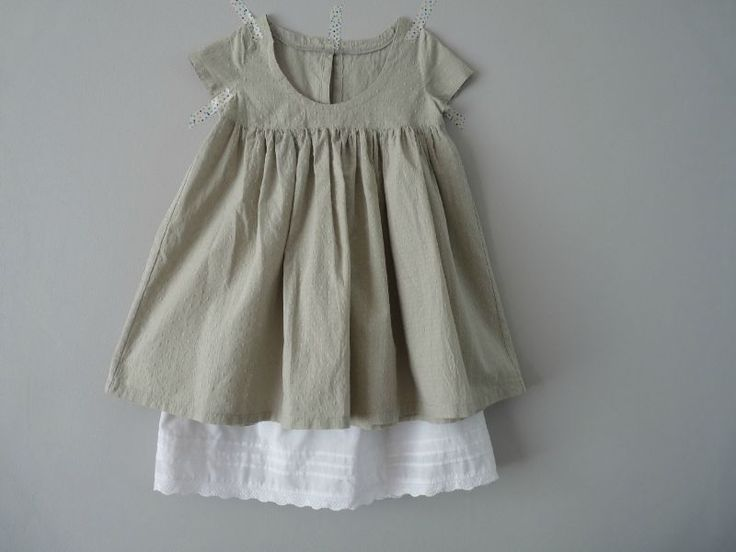inspiration: use dad's shirt, make it a skirt, add with ruffly fabric underneath? I see sewing in my future