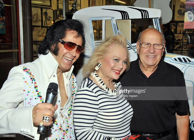 Songwriter Carol Connors (L), Elvis' Best Man Joe Esposito (R), and Elvis impersonator attend Elvis hit making team 'The End'CD launch and George Barris book signing 'Barris Cars of the Stars' on September 22, 2009 in North Hollywood, California.