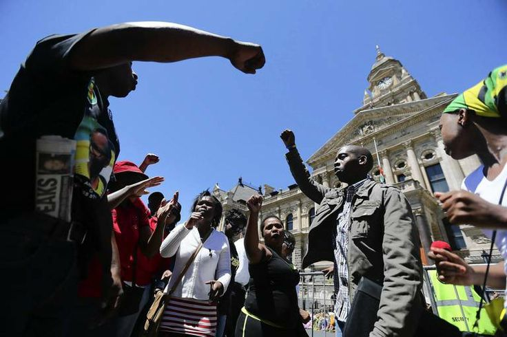 South African mourners sing and dance in front of the Cape Town City Hall where the late South African president Nelson Mandela made his fir...