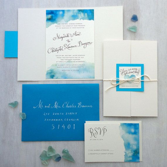 This invitation is printed on white cover stock, mounted on a textured white gate fold card. The outside of the invitation has a tag with a watercolor heart and is tied off with cotton string. Bride and groom names are hand written in script style and printed. SIZE: 5″ x 7″ COLOR: seaglass blues, tabriz blue & white SAMPLE INCLUDES: invitation, response card, tabriz blue outer envelope and white response envelope Other colors available upon request. Thank you notes, table cards, save th...