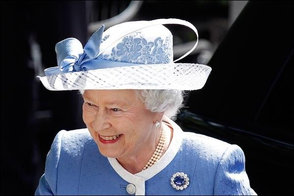 The queen pictured during a visit to the Irish National Stud Farm in Kildare, Ireland. Once again the hues on the ribbon-and-bow-decorated hat match that of the queen's dress. And the floral prints on the hat perfectly fit into the picture.  (May 2011)