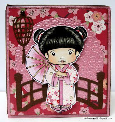 Creations by Patti: Asian Marci Tissue Box Holder  Face: E000, E00, E11, R11, R20 Hair: W2, W4, W6, W8  Hair decorations: Gold Smooch pen, B000, B23, B91 Umbrella: R56, R59, RV91, E34  Kimono Trim: B91 Yuzen Printed Japanese paper pieced used for her dress and center of umbrella.