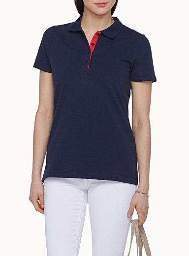 Simons, $24.95 $19.99 Style: 11318-14751, Exclusively from Contemporaine     The basic polo T-shirt in a stretch cotton knit   Half-length buttoned placket with a contrasting underside   Fine-ribbed neck    The model is wearing size small