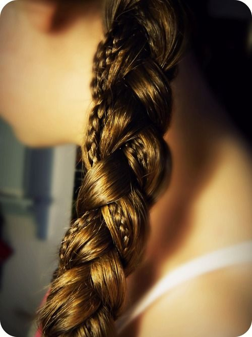 Small braid incorporated into a large braid. One of my favorite hairstyles.