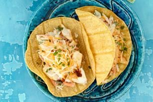 Baja Fish Tacos recipe - Dude, flaky fish wrapped with tangy coleslaw in a corn tortilla equals awesome surfer soul food. Totally.