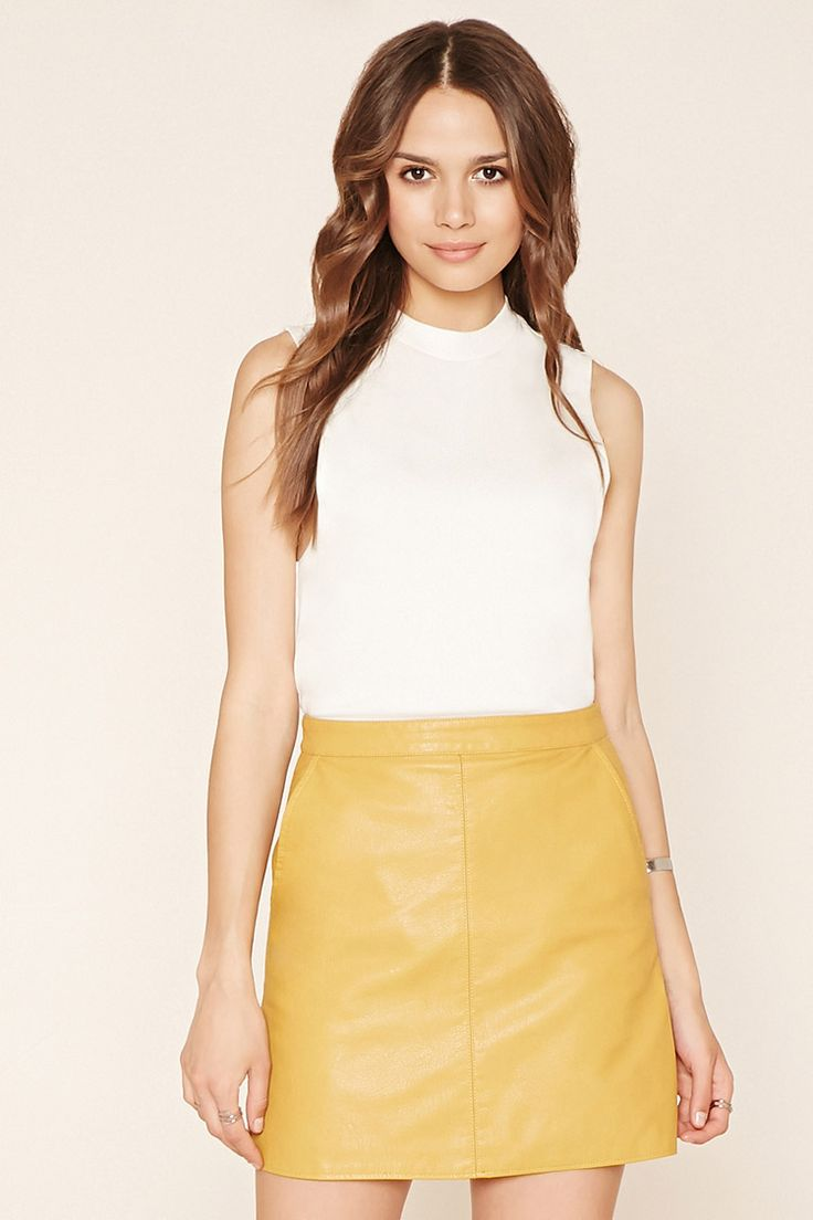 Forever 21 Contemporary - A faux leather A-line skirt with an exposed back zipper and slanted front pockets.