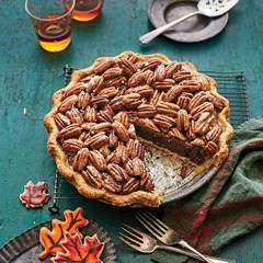 Some say peanut pie is a poor man's version of pecan pie. Others say its salty-sweet punch was inspired by a now-vanishing gas station treat created by pouring a five-cent packet of salted pea- nuts into a bottle of ice-cold Coca-Cola. Either way, it's a crackerjack pie. It's at its finest made with roasted, meaty Virginia peanuts grown in the sandy soil of Tidewater Virginia and North Carolina. We enriched the classic filling with peanut butter and replaced the typical Karo with maple syrup…