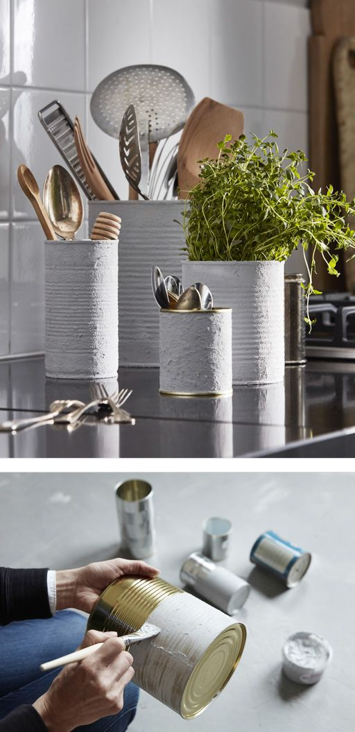 Metal cans painted with a cement-style paste to have another life as kitchen worktop containers