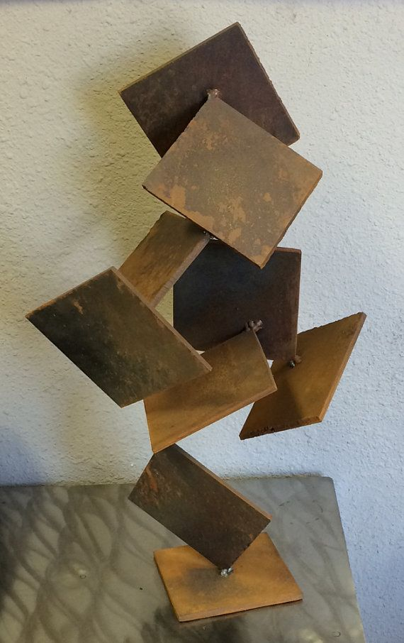 "Rustic sculpture by ArtWelding4U on Etsy. This is another one of my VERY rustic sculptures. This piece has uneven edges which are visible in the zoomed in picture. This sculpture has a different look depending on what angle it is seen from. This piece is made from steel and has a rust patina finish, the squares are 5 1/2""x 5 1/2"" welded in an abstract manner and stands about 2"" tall and is 1"" wide. Sells for $80."