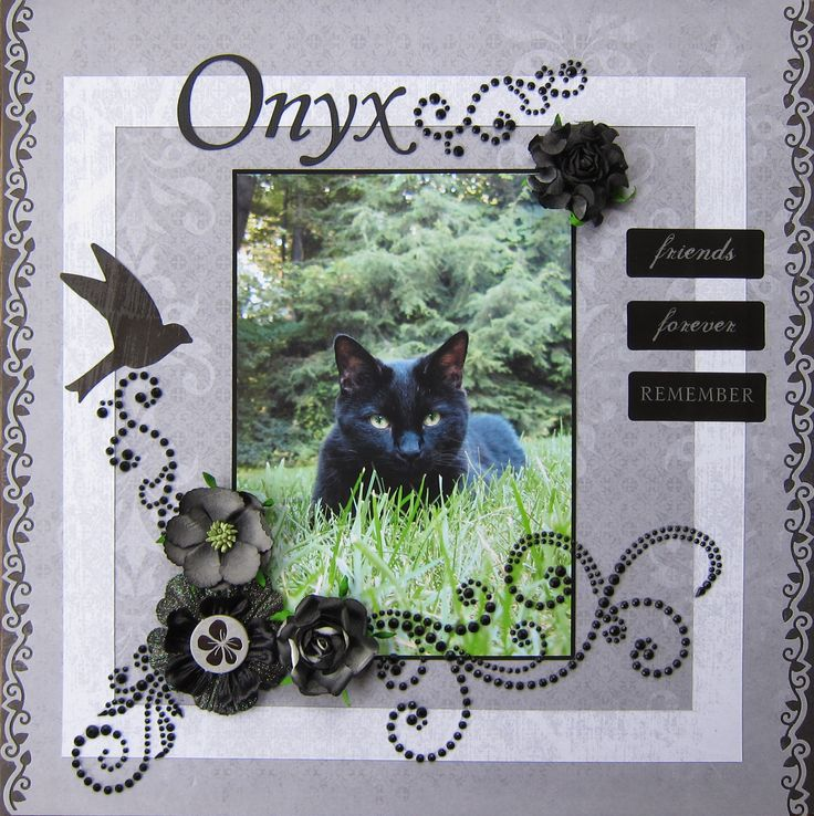 In Memory - Scrapbook.com The black cat and the black embellishments are striking.