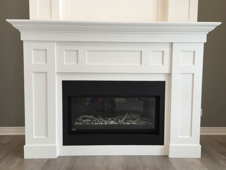 """Forest Ridge Crt.: 18 foot tall gas fireplace in SW7004 """"Snowbound""""."""