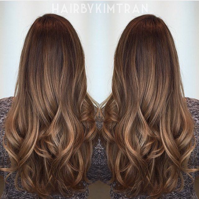 Shadowed brunette roots and caramel hints.