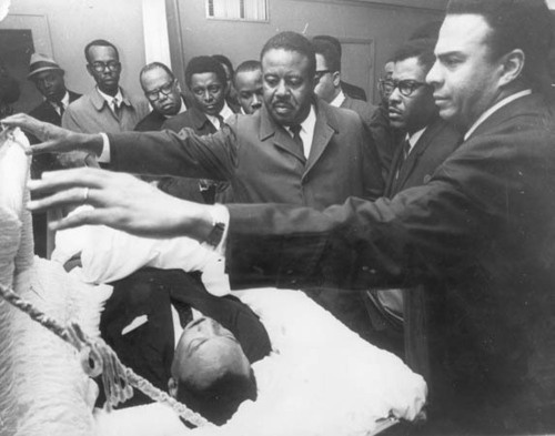"""""""King's aides, from right, Andrew Young, Bernard Lee and Ralph Abernathy, lead the mourning of their slain leader."""""""