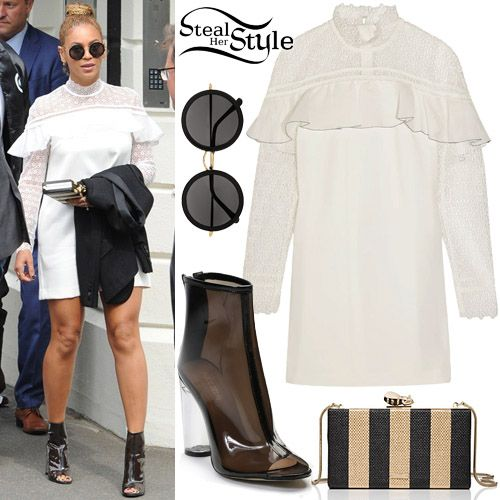 Beyoncé was spotted at Wimbledon Tennis Club in London wearing a Self-Portrait Ruffled Guipure Lace and Crepe Mini Dress ($433.00), a Kate Spade Down The Rabbit Hole Bee Clasp Clutch ($262.00), The Row Round Sunglasses ($99.00 – wrong color) and Public Desire Star Perspex Heel Ankle Boots ($59.99).