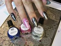 I really love my DRK Themes Enlaced plate and my DRK stamping polishes. :)