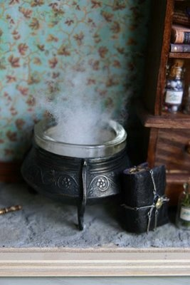 "cauldron with batting as ""steam"""