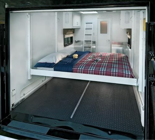Queen-size electric drop-down bed in cargo area