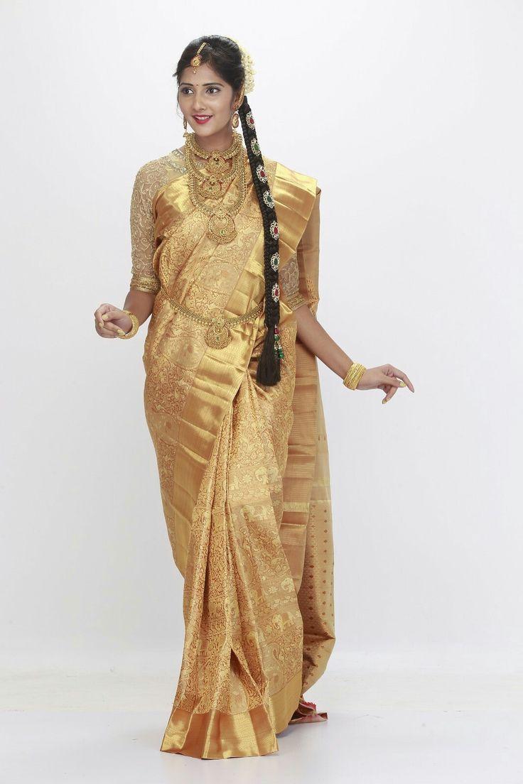 Cream wedding saree in 1 Gram gold zari from silk saree makers. You can buy at http://kanjivaramsilks.com/wedding-sarees-online/silk-00abrid4003.html Tags: #weddingsarees #silksarees