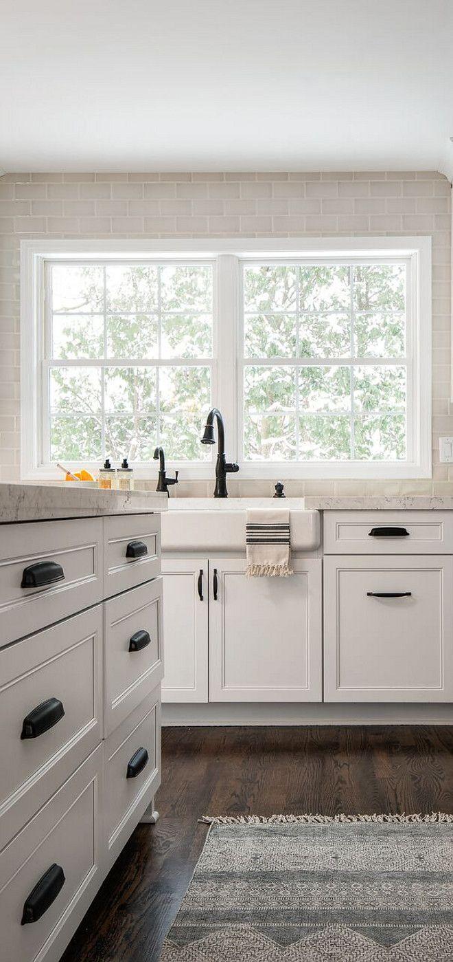 white kitchen with restoration hardware dakota knobs pulls and cupboards