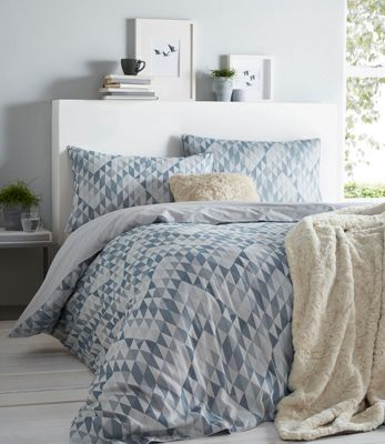 Refresh and brighten up a bedroom interior with this duvet set from The Collection. Woven entirely from cotton for comfort, each piece comes in a bold geometric design and features a simple understated reverse.