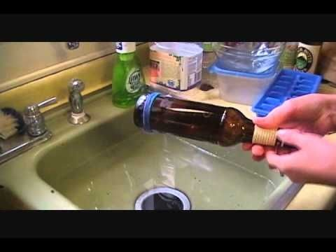 How to cut a glass bottle with stuff you already have at home--a bottle, yarn, nail polish remover, and cold water!.