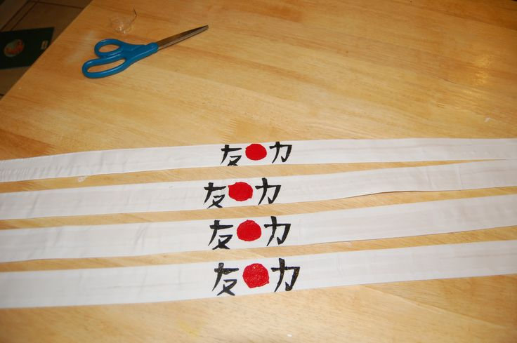 Ninja headbands for my son's ninja birthday party. I made a stencil with the Japanese characters for strength and friendship, and stenciled them with craft[paint onto headbands I'd made out of inexpensive white muslin.